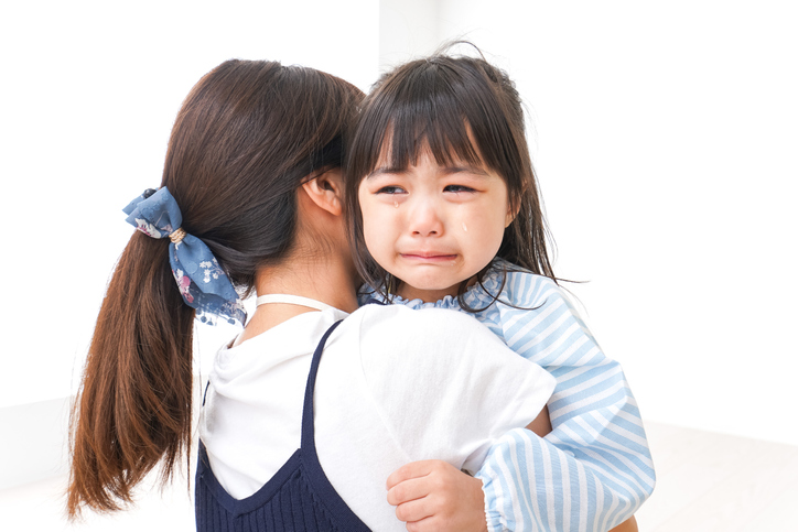 Crying child and mother
